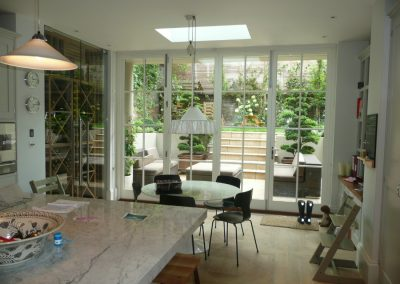 Georgian style timber bifold doors at Wimbledon home. Incorporates Centor bifold door gear