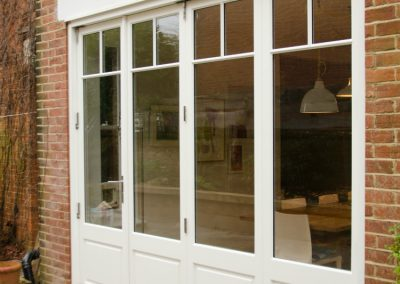 external view of wooden bifold doors in Wimbledon